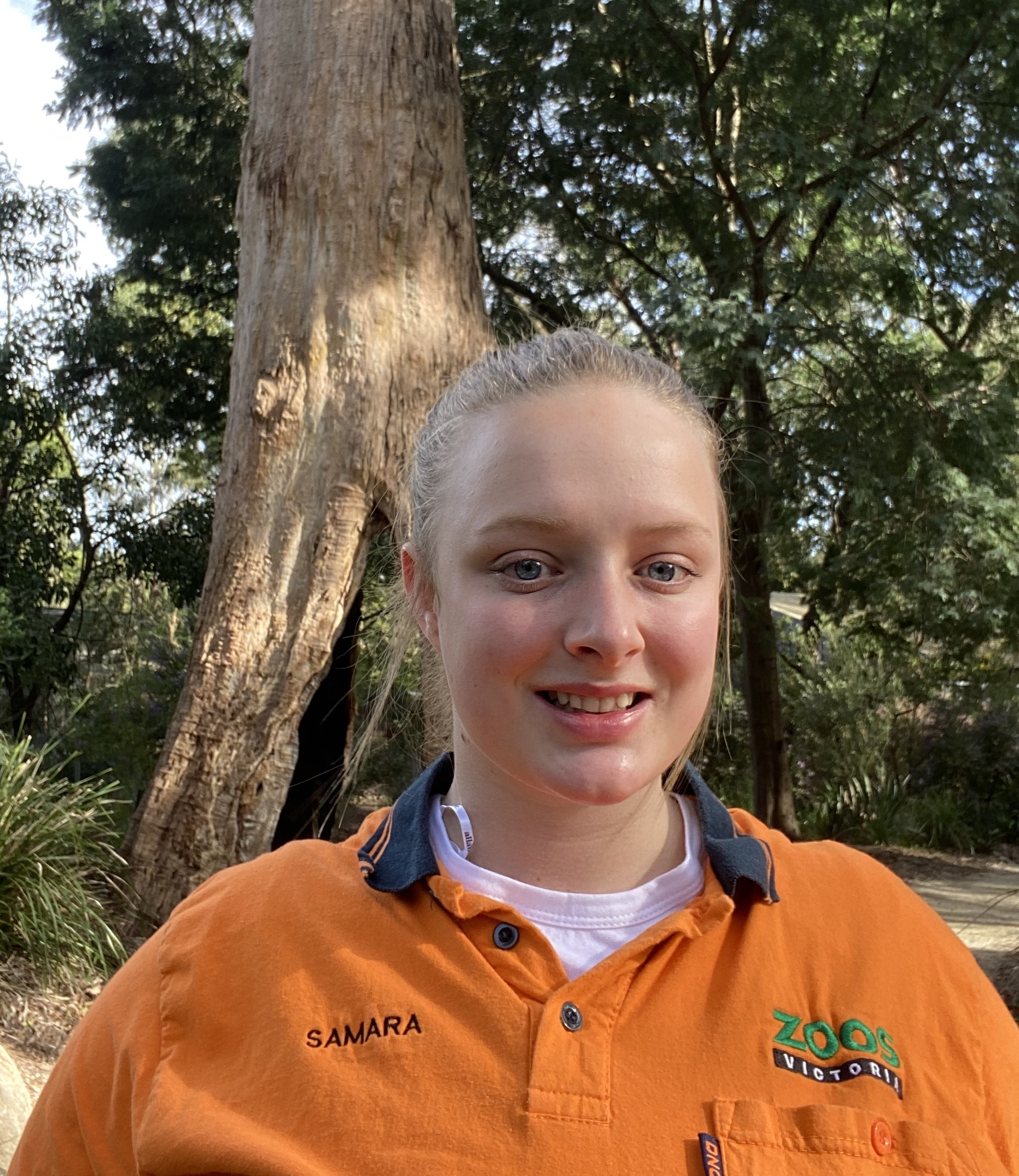 Samara Draper standing in front of a tree