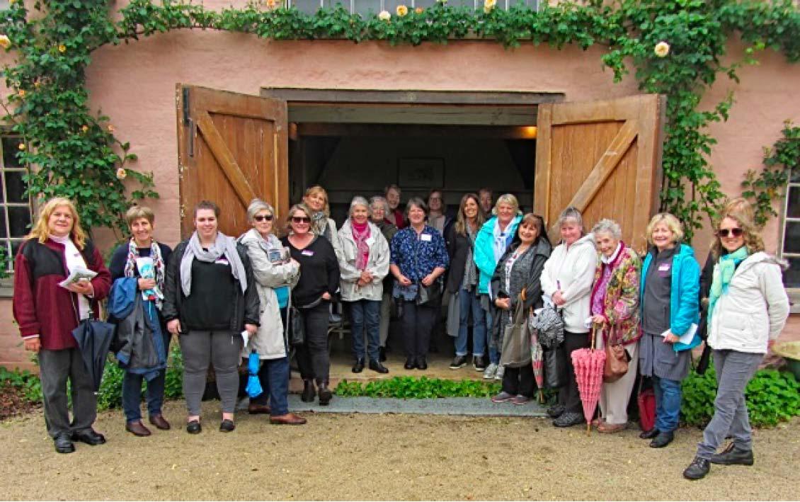 EWHA members standing in front of a doorway
