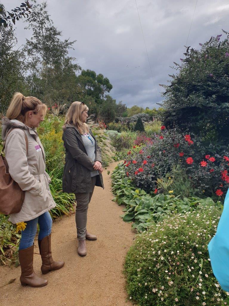 Two women admiring the The Perennial Border Garden