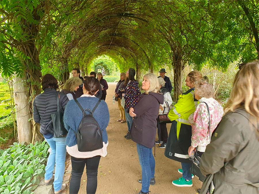 people standing under the grand Wisteria Archway