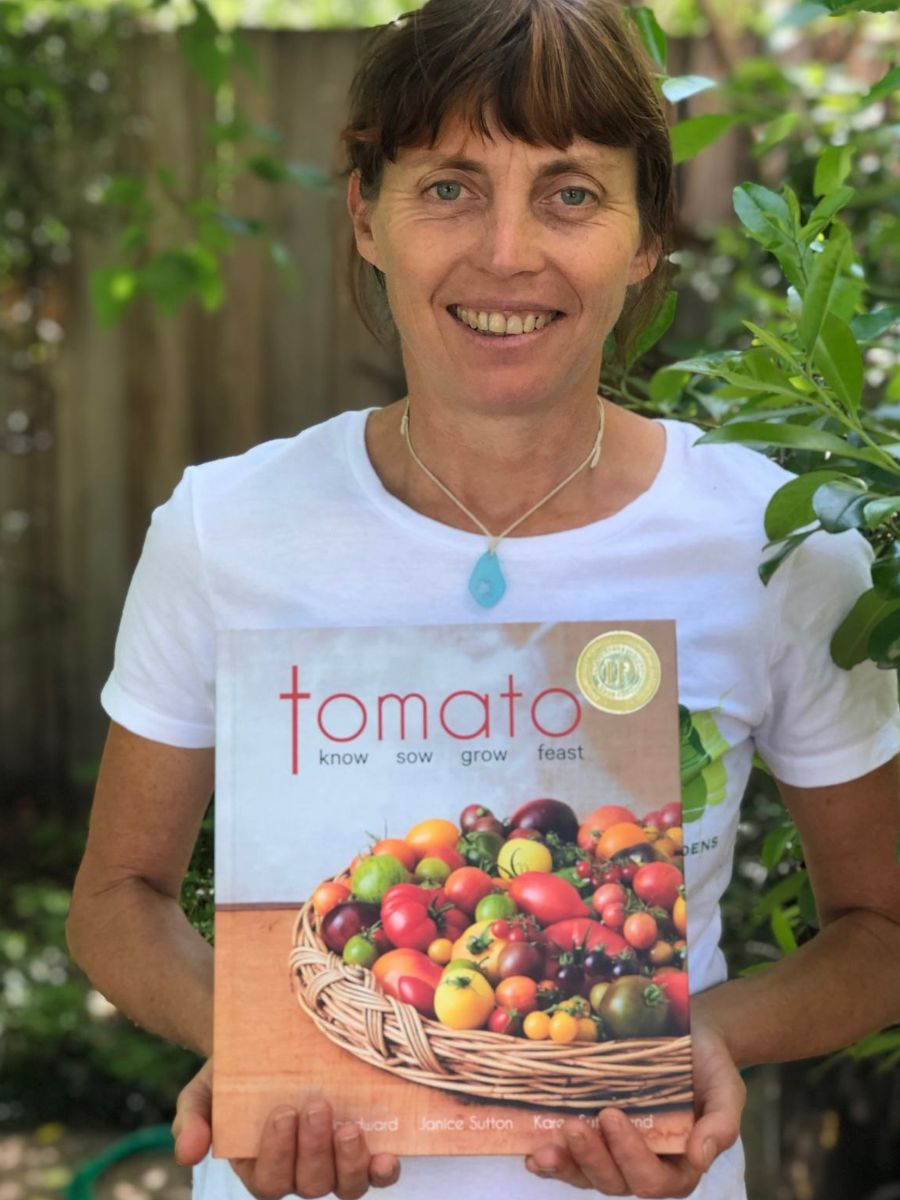 Karen holding a basket of tomatoes