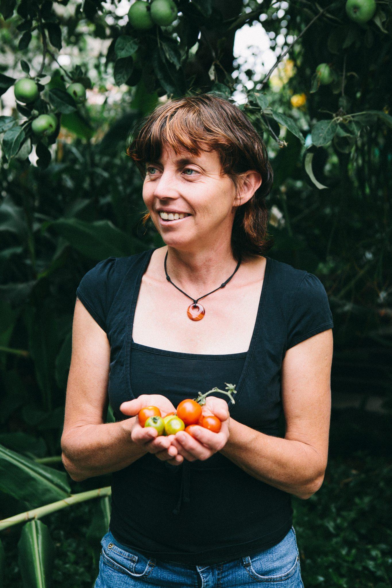 Karen holding tomatoes